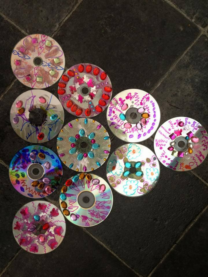 Decorated CDs at Cathy's Childminding ≈≈ Would be fun to have the kids decorate a cd, and hang all them from the tree in the yard