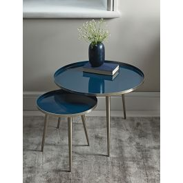 Crafted from sturdy powder coated iron with a deep blue, glossy enamel top, our unique side tables will make a Scandi inspired statement in your living space. The perfect occasional surface for your home, their slender, brushed gold legs create an elegant silhouette.