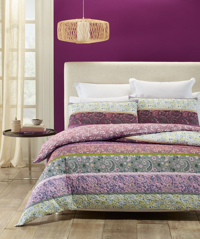Luxurious soft touch quilted look fabric. Blend of Purple, Lilac, Brown, Mustard, Grey, Mint, Blue and White