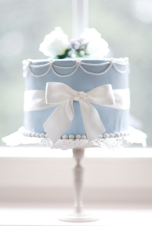 Charming Wedgewood Blue Wedding Cake with draped beading, flowers and wrapped in a white bow...Pretty! | Love You More ᘡղbᘠ