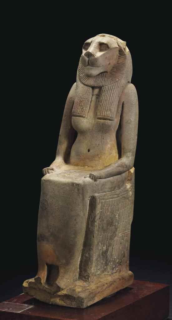 Glazed steatite statue of the goddess Bastet enthroned. Third Intermediate Period. 22nd dynasty. 945-715 B.C. | Christie's