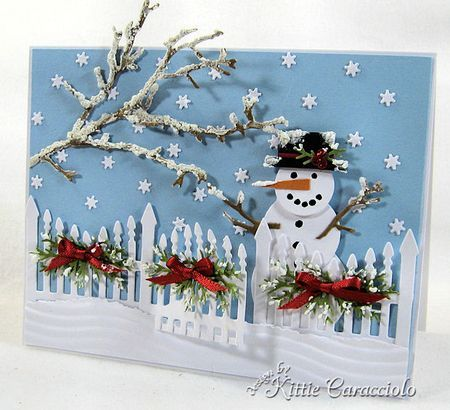 cute snowy yard scene with snowman, fence decorated for Christmas and a tree…