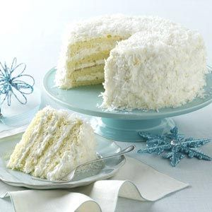 Pineapple Coconut  Cake Recipe -This coconut cake is a guaranteed showstopper at any holiday meal. The beautiful flakes of coconut are reminiscent of snow. But one taste of the sunny pineapple will transport you to the tropics.—Monica Kennedy, Johnson City, Tennessee