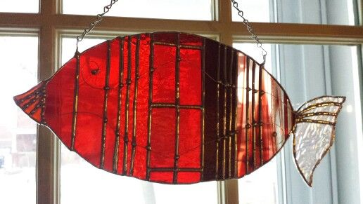 "Stained glass fish! Decorative solder & wire used. This panel is approximately 12"" W x 6"" H Done with shades of red!"