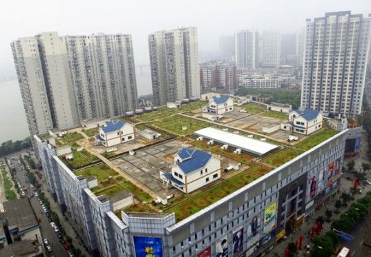 The city of Zhuzhou in Hunan, China is taking the idea of green roofs to new heights with a shopping mall topped with a lush living roof and a four-villa development.