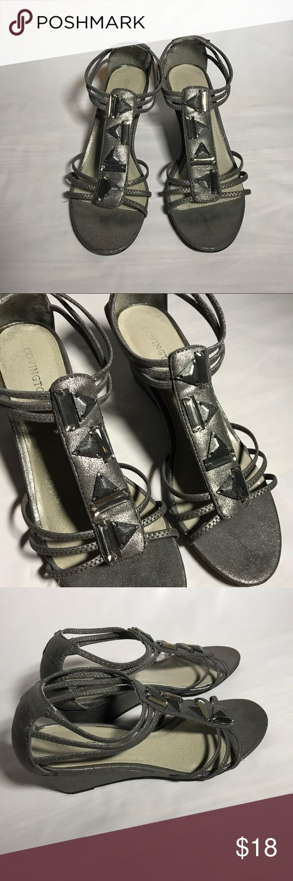 Covington Daisy Wedge Heel Used condition. Has small gray marks on the sole of the left shoe. Accented with triangle and rectangle shapes on the front of each shoe. Gray tone shoe. Bottom of shoes demonstrate usage. Covington name on soles have fading. Covington Shoes Wedges