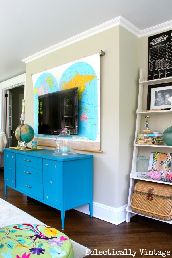 Gorgeous sunroom tour - divided into 3 zones - brilliant!  and that map wall!  eclecticallyvintage.com