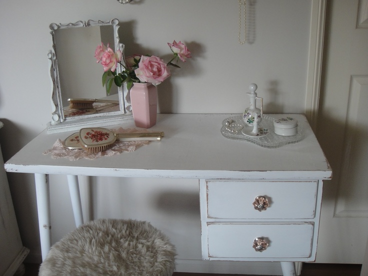 Give me an old piece of furniture any day, they hold so much character and charm you won't find with the modern pieces of today. This old desk makes a lovely makeup dresser.