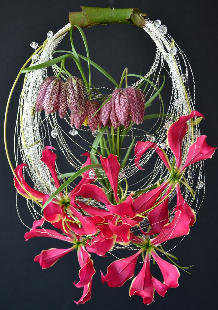 "ooo!!!  love the leaf-wrapped ""handle"" detail. ""purse"" style circle bouquet of frittilaria and gloriosa lilies."