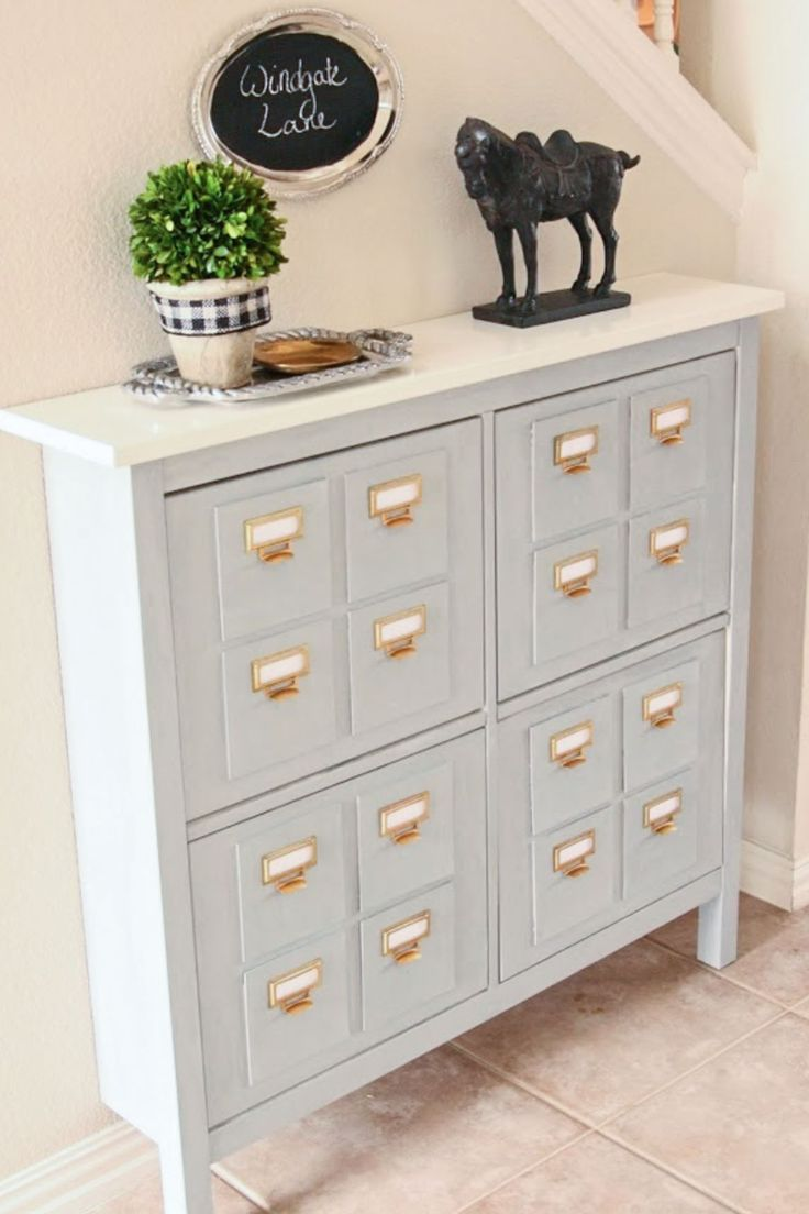 behind the French door? useful for shoe storage, and dropping stuff on the  way in the door. CardCatalog from