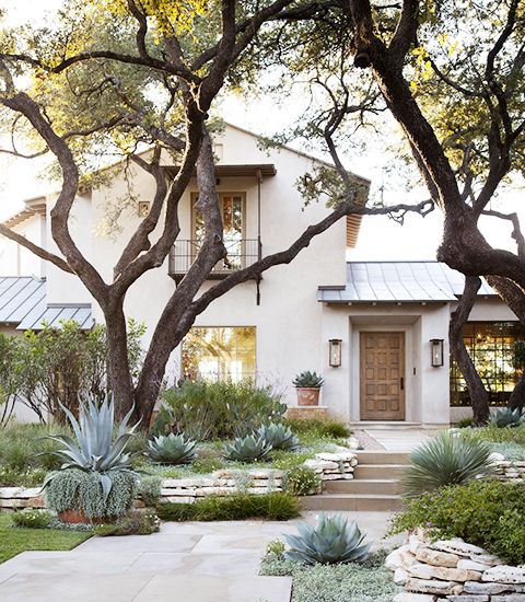 quite literally my dream home. mid-century modern with a southwestern/spanish flair, and landscaping that feels like a mash-up of australian bush forest and the arizona desert.