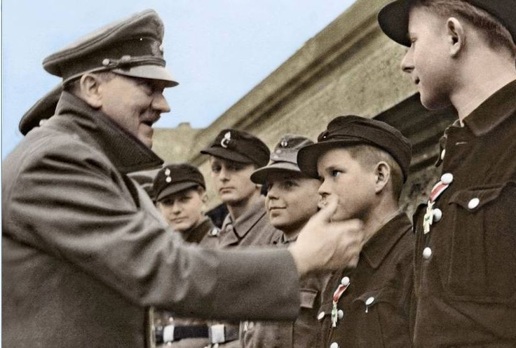 One of the last photos of Adolf Hitler reviewing children soldiers as the Battle of Berlin unfolds, March 1945.