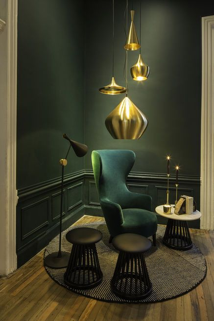 A collection of Dixon's new gold pendants hangs in the Bar Club. #ISaloni #ISaloni2015 #Salonedelmobile #Milan #Salone2015