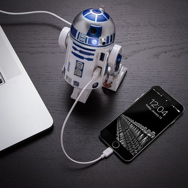 The R2-D2 USB 3.0 Charging Hub is almost as good as having the real droid. This R2 unit has 4 USB 3.0 ports in the front and lights up and beeps and whistles wh