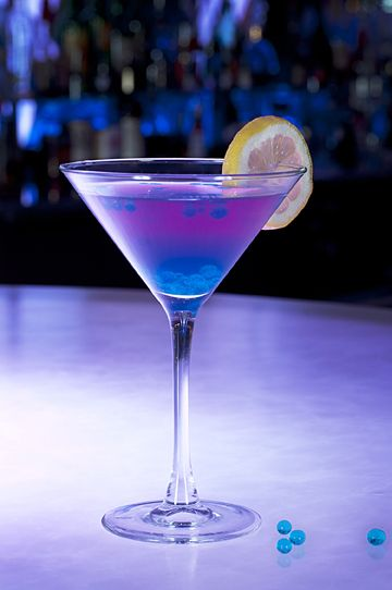 bejeweled martini - Champagne, raspberry vodka and Blue Curacao with spheres of Blue Curacao