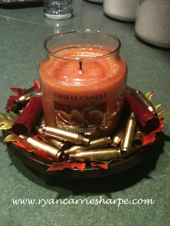 Centerpiece for hunting season...I'd change out the Yankee candle to a free-standing wax version though.