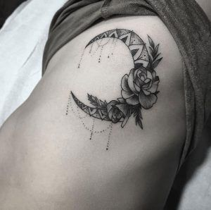 Ornamental moon tattoo with rose accent by Justin Hobson