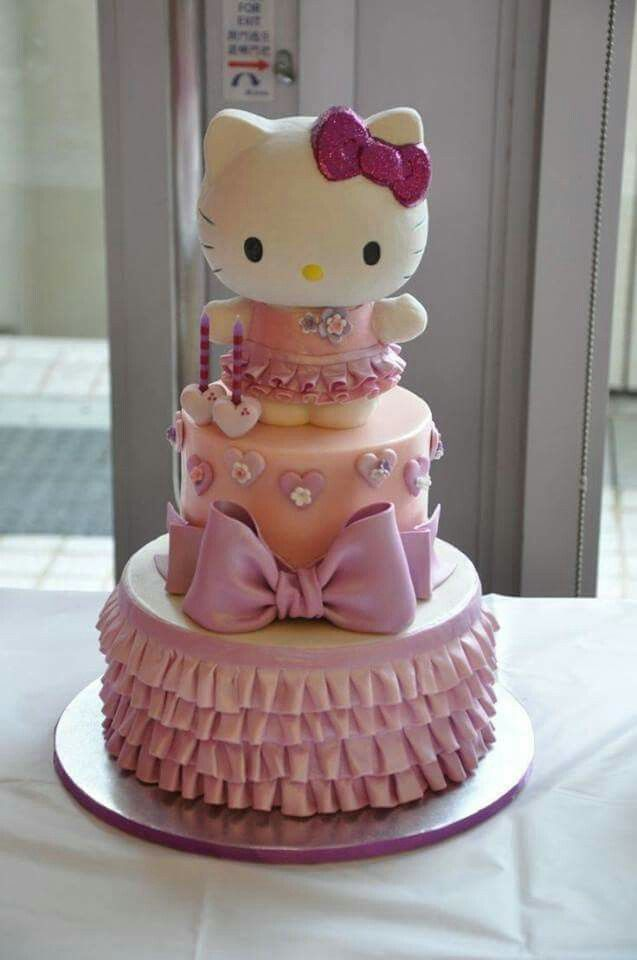 Hello kitty pink 2 tiered cake.