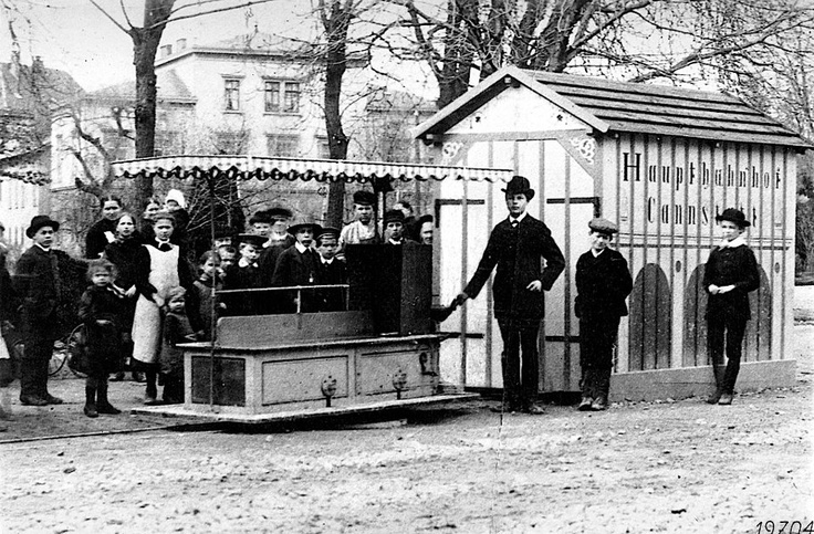 1887: Gottlieb Daimler builds motorized streetcar --- Gottlieb Daimler puts a miniature tram into operation at the Cannstatter Volksfest fair. The vehicle is powered by a single-cylinder Daimler engine and plies between Wilhelmsplatz and the Kursaal.