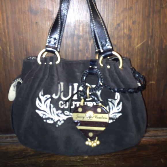 Juicy couture baby fluffy handbag Cute small black juicy purse! Gently used. A few marks in the inside of the purse from wear but still a lot of life left!! One small scuff on the charm as shown in the picture! Juicy Couture Bags Mini Bags