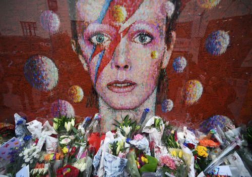 Photos of the day - January 10 2017Flowers and tributes are...  Photos of the day - January 10 2017  Flowers and tributes are placed by an art work of David Bowie on his first death anniversary in Brixton London; a model poses by the 2018 Audi S5 Cabriolet during the North American International Auto Show in Detroit Michigan; and laundry of Syrian refugees is covered with snow while hung on a fence at the refugee camp of Ritsona about 53 miles north of Athens; a woman with two dogs walks…
