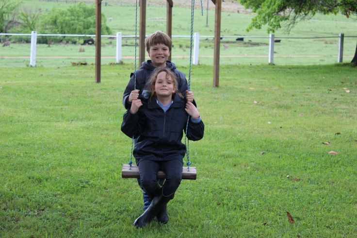 Archie and Rissie, hard at work at Bolivia Station Homestead.  How is it that kids can always find the swing?