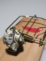 Place a large crumpled-up bill inside a trick mouse trap for a humorous gag gift.