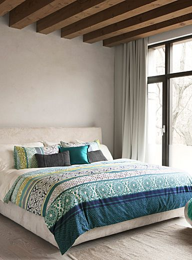 """An Australian design exclusively at Simons Maison   A new take on tapestry by combining flowers and geometric patterns in an inventive and modern patchwork. Matching reversible pattern.  100% cotton percale in 250 thread count.   The set includes:   Twin: 1 duvet cover 66"""" x 90"""", 1 pillow sham 20"""" x 26"""" Double: 1 duvet cover 84"""" x 90"""", 2 pillow shams 20"""" x 26"""" Queen: 1 duvet cover 90"""" x 95"""", 2 pillow shams 20"""" x 30"""" King: 1 duvet cover 108"""" x 95"""", 2 pillow shams 20"""" x 36"""""""