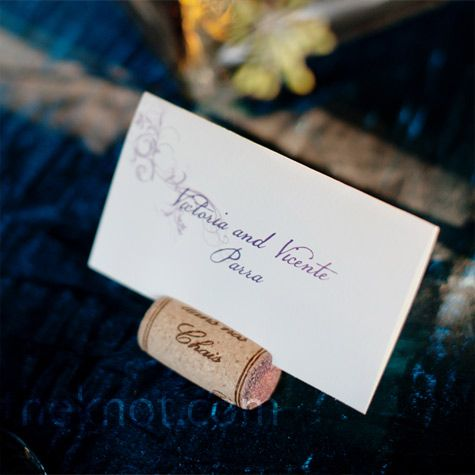 Guests' names were written onto ecru cardstock with plum-color motifs fixed inside corks.