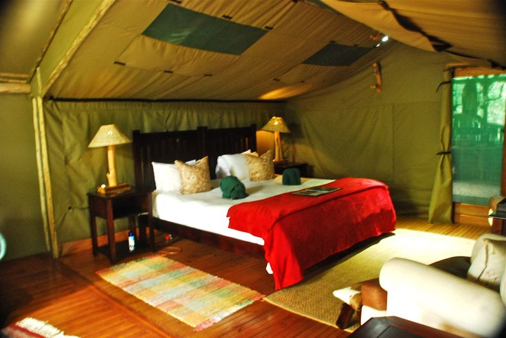 The bedrooms are beautifully appointed with all the comforts. At Sibuya Game Reserve Forest Camp reached via boat along the Kariega River from Kenton on Sea, Eastern Cape, South Africa www.sibuya.co.za