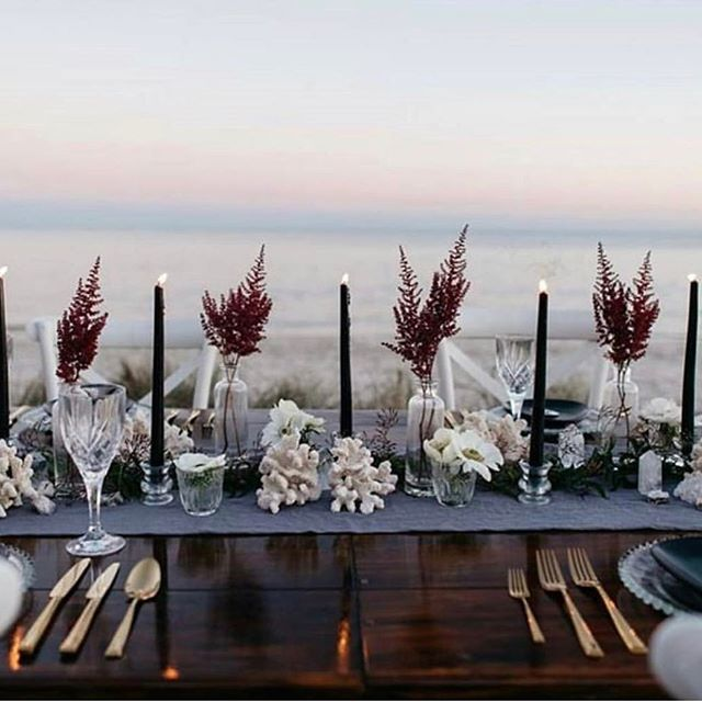 When your venue has this view don't complicate - complement! The perfectly simple florals and single candlesticks give casual sophistication. For more inspiration visit the STUNNING @mrs_myrtle crystal #stylist #waterfront #events #centrepiece #eventplanner #tablescape #wedding #weddinginspiration #dinnerparty #flowers #instawedding #seaside #gold #beach #florist #black #tablesetting #entertainer#eventprofs #meetingprofs #eventplanner #eventtech