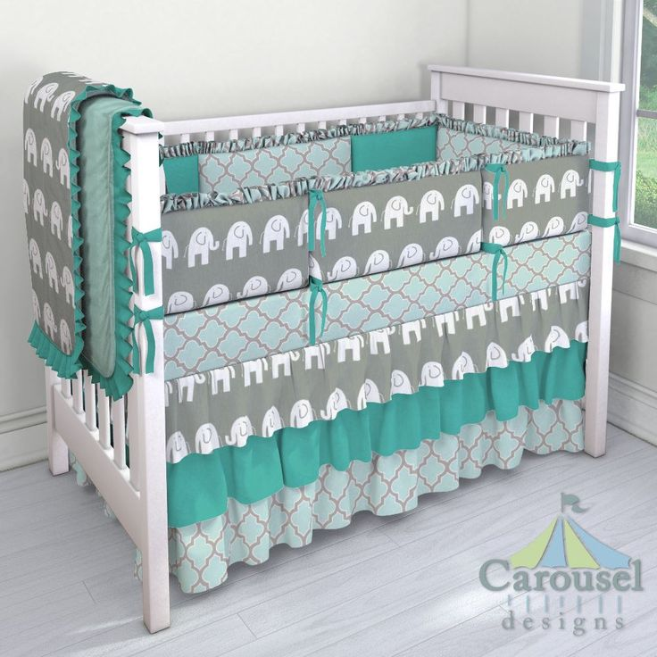 Crib bedding in Solid Seafoam Aqua Minky, Gray and White Elephants, Solid Emerald Turquoise, Mint and Taupe Hand Drawn Quatrefoil. Created using the Nursery Designer® by Carousel Designs where you mix and match from hundreds of fabrics to create your own unique baby bedding. #carouseldesigns