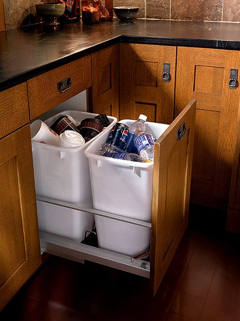 Wood-Mode/Brookhaven  Recycling organization is a must-have these days and Wood-Mode Fine Custom Cabinetry features convenient  pull-out center w/ 2 bins.