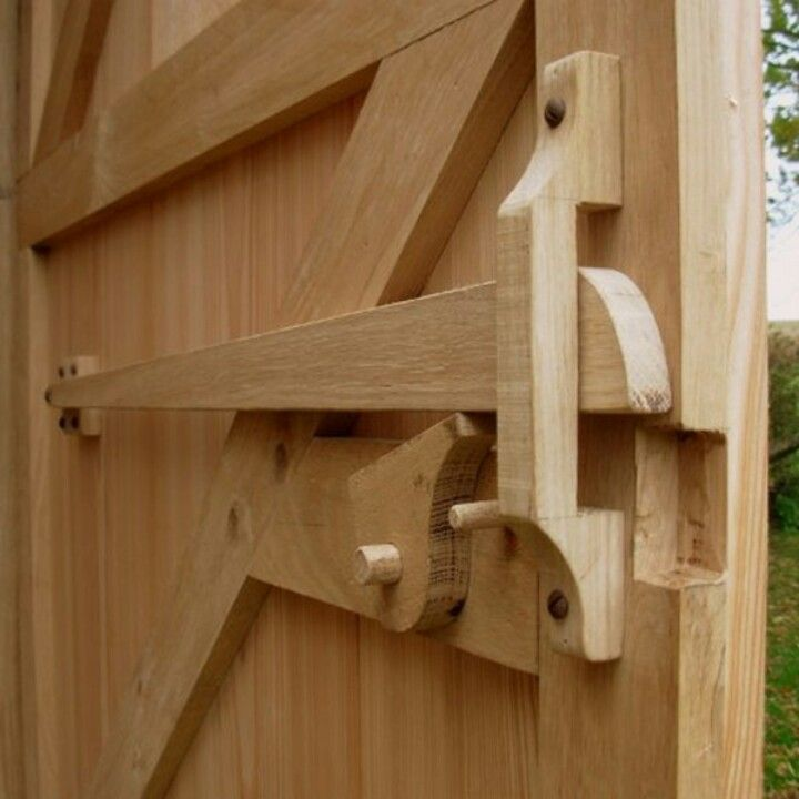Wooden door latch from garden tool wall shed