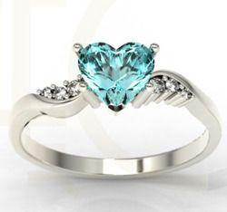 Pierścionek z białego złota z topazem Swarovski Blue i cyrkoniami / Ring made from white gold with Swarovski Blue topaz and zircons / 840 PLN / #jewellery #engagament #ring #whitegold