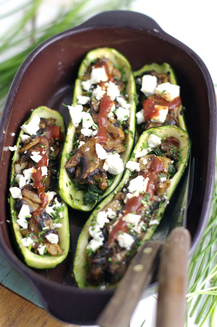 Zucchini Boats are a delicious way to embrace zucchini season: stuffed with mushroom, feta, spinach and Barker's Habanero Tomato Relish!