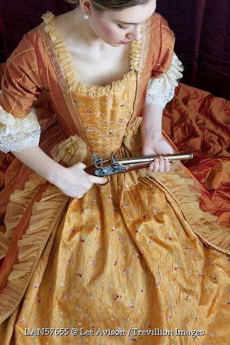 © Lee Avison / Trevillion Images - 18th Century-woman-with-flintlock-pistol