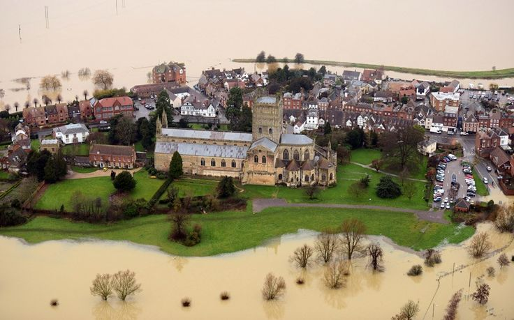 January 2014 - Britain enduring the worst series of winter storms in more than 20 years: Tewkesbury Abbey cut off by floods