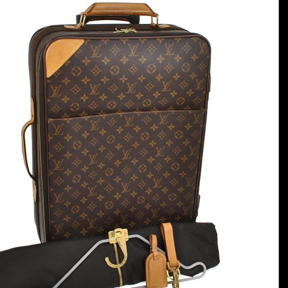 Authentic Louis Vuitton Pegase 55 Suitcase Authentic monogram travel carry wheels handle Extra Large Suitcase,Very rare to buy. ORDERS ONLY ONLY 7 LEFT IN MY INVENTORY.Rubber has a teeny crackle the tire has peeled slightly,handle has small black stain and a little suntan,ht 22 inches dpth 7.5 lgnth 14.2. Made in France of Genuine Leather of the highest quality..still very good cond.Takes 3 weeks to ship as I have to unpack it from my temperature controlled storage unit,taking orders..no…