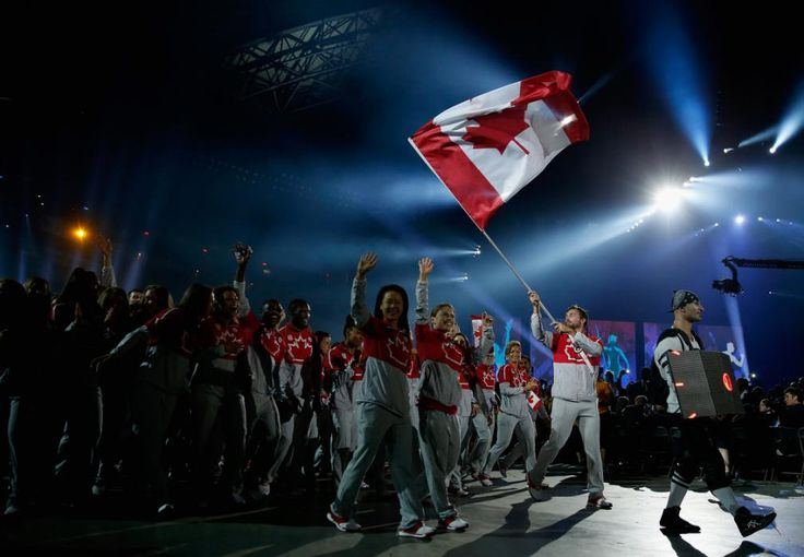 TORONTO, ON - JULY 10: Mark Oldershaw carries the flag for Canada during the Opening Ceremony for the Toronto 2015 Pan Am Games at Rogers Centre on July 10, 2015 in Toronto, Canada. (Photo by Ezra Shaw/Getty Images)