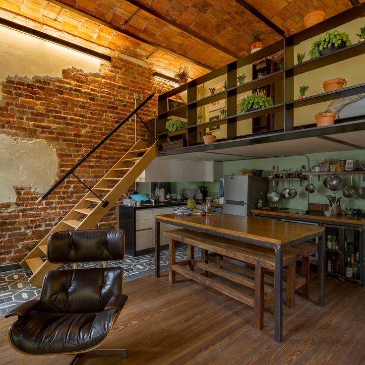 like the wood, stone, brick (not that we would use), metal. Like the tucked away kitchen that looks into the larger space. Like the metal/wood table/counter