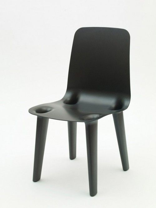 Carbon Chair, Black, Detail Where The Legs Join With The Seat.