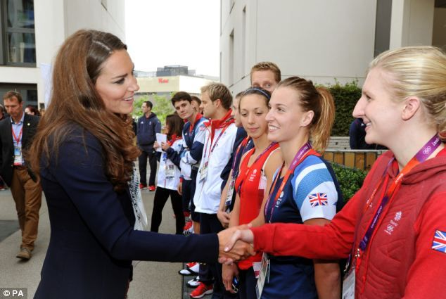 The Duchess of Cambridge laughs as she talks with Great Britain swimmer Rebecca Adlington during a visit to the Team GB accommodation flats in the Athletes Village at the Olympic Park in Stratford, east London