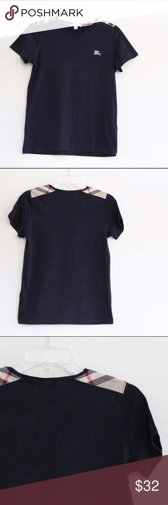"Burberry Navy Tee Tag says size 14Y - for children but can fit a female size XS/S  Measurements: Bust: 17.25"" Shoulder: 14"" Length: 24""  Smoke-Free & Pet-Free Home No Model Photos NO TRADES Reasonable Offers Welcome Burberry Tops Tees - Short Sleeve"
