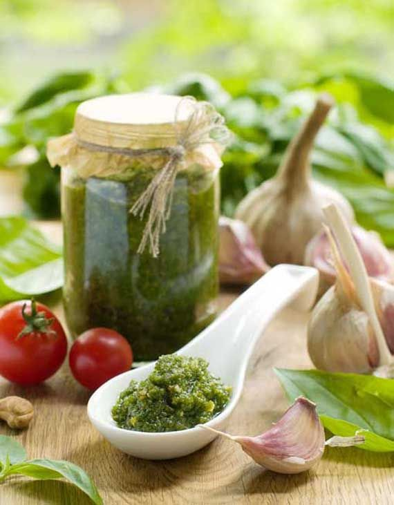Clean Eating Traditional Pesto: 1 cup fresh basil, packed, 7 cloves garlic, 1/2 cup olive oil, 1 cup parmesan, cheese, 1/2 cup roasted pine nuts, Salt and black pepper to taste