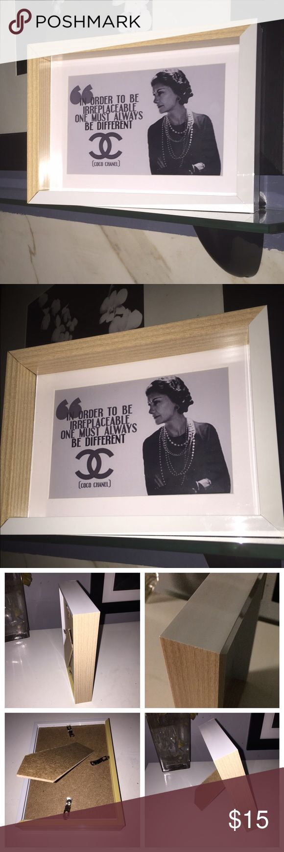 Chanel motto print with deep picture frame Chanel motto high gloss Print with deep box picture frame. Print measures 4x6 & comes with the picture frame, frame can stand alone , art easel lean or hang on wall. Great on a desk , in a closet , on a nightstand. Even in the bathroom . Show your sense of fashion & style beyond your wardrobe !!! GREAT GIFT OR STOCKING STUFFER FOR THE HOLIDAYS. CHANEL Other
