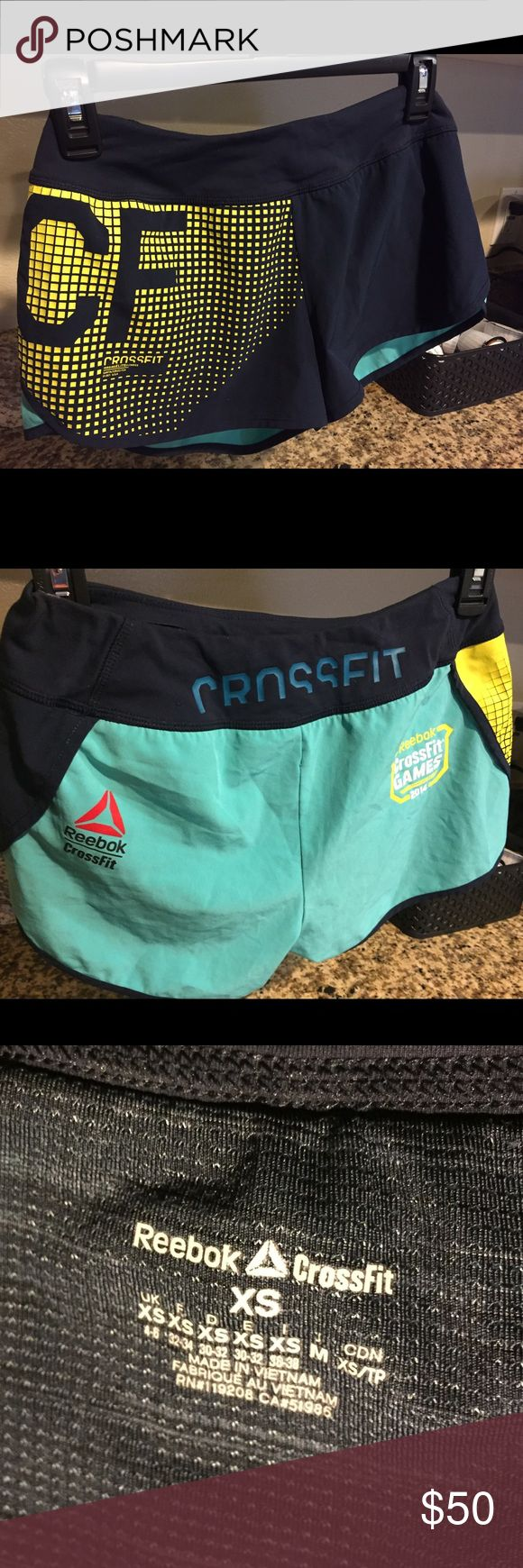 Reebok CrossFit Games 2014 Shorts Teal/Mint Navy 2014 women's Reebok CrossFit shorts - Size XS (fit like a small) in a teal/mint back with a navy blue and yellow front print. Worn maybe 4-5 times reebok Shorts