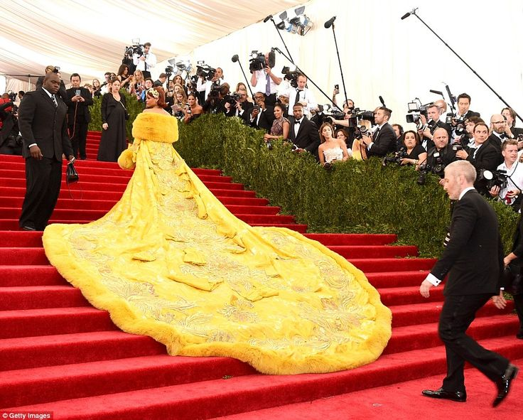 'I'm so in love with this dress': Rihanna admitted that the train was 'insane' as she chat...
