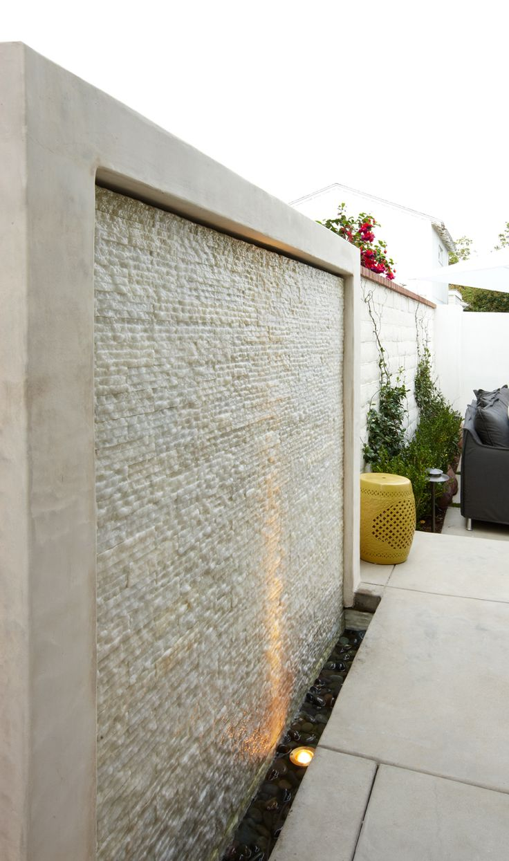 Water wall using Cream pencil Stone for the divider between the patio and driveway. Visual and auditory interest. https://www.pebbletileshop.com/products/Cream-Pencil-Stone-Mosaic-Tile.html#.VJNKqCvF-1U