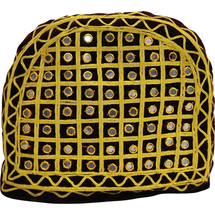Here is a vintage handmade burgundy velvet and gold rick rack cord trimmed tea cosy. The cozy is embellished with small round mirror disc tiles. It is